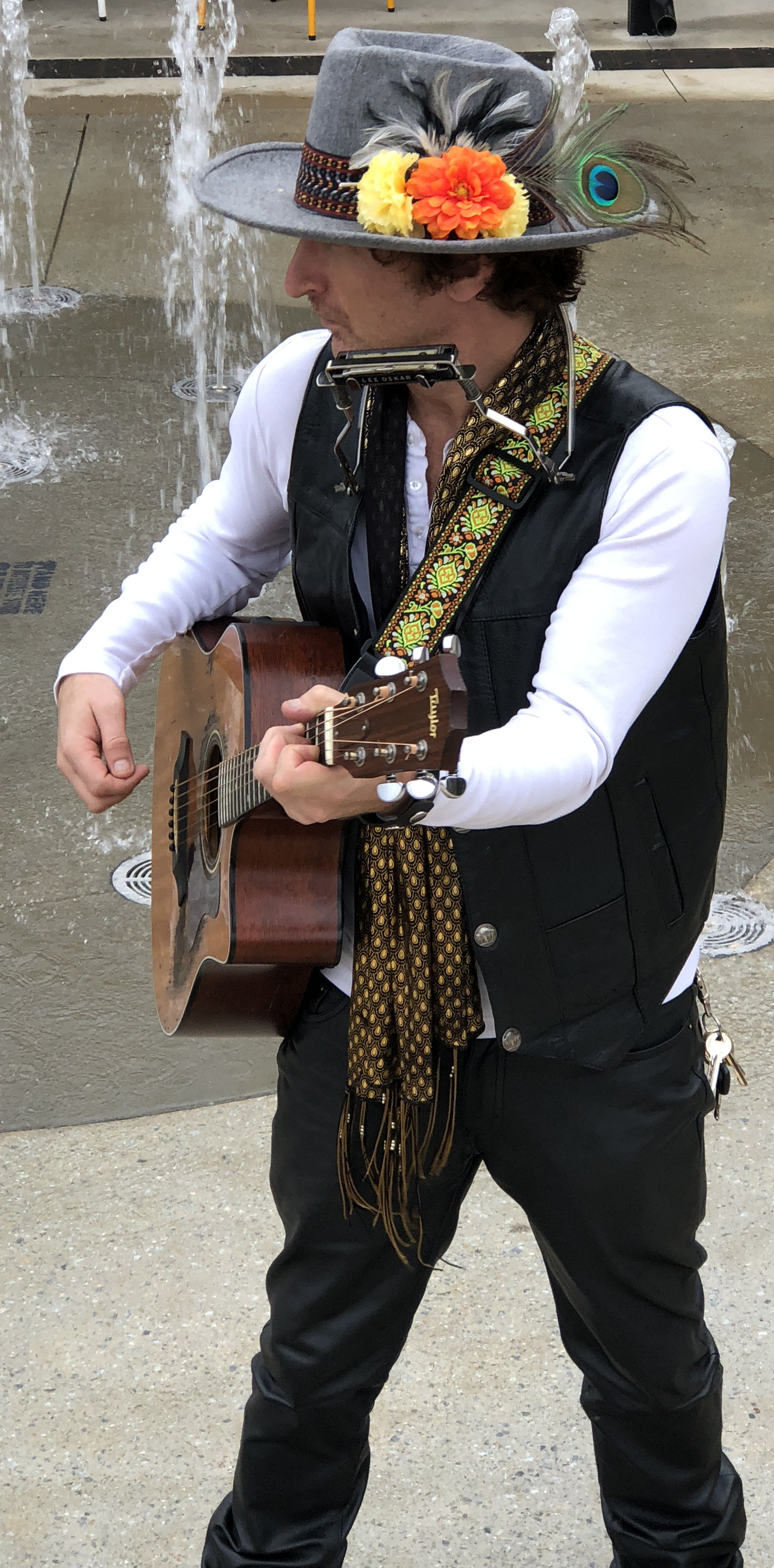 Ashley Collins as Bob Dylan